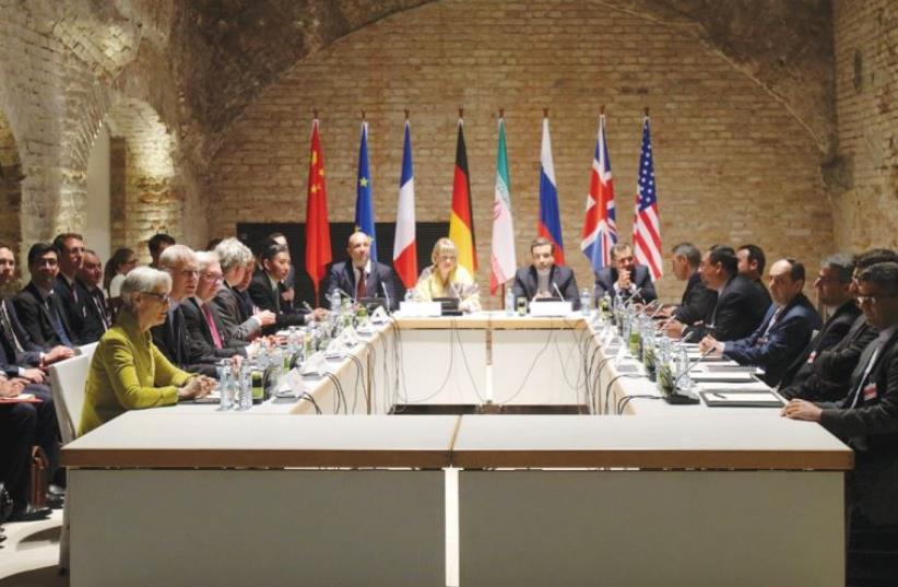 NEGOTIATORS FOR Iran and six world powers are shown meeting in the historic basement of the Palais Coburg Hotel in Vienna in April. (photo credit: REUTERS)