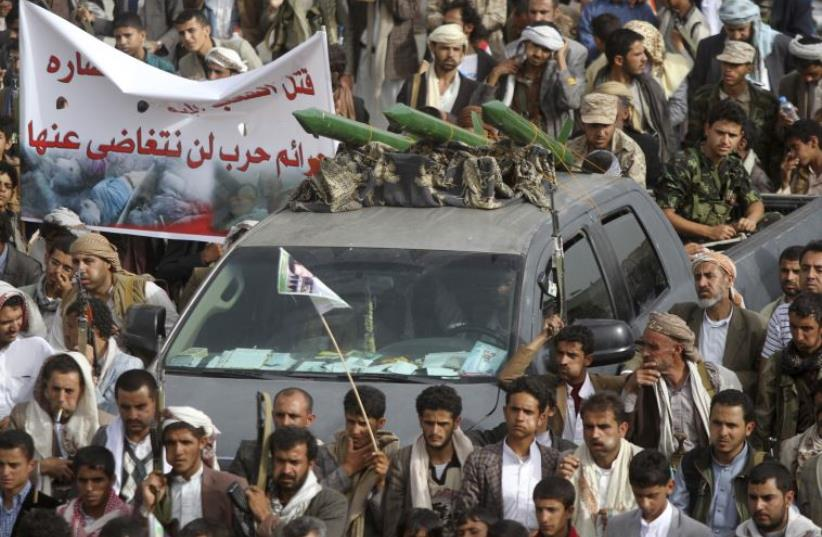 Mock missiles are mounted on a truck during an anti-Saudi demonstration by Houthi followers in Sanaa, Yemen, June 5, 2015 (photo credit: REUTERS)