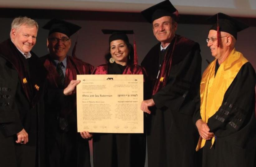 SHIRA RUDERMAN (center) is awarded an honorary doctorate at the University of Haifa. (photo credit: GIL HADANI)