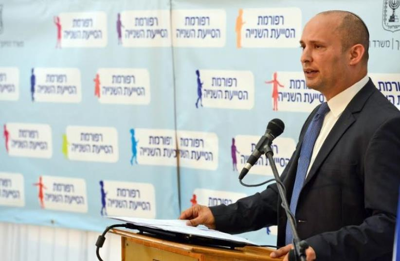Education Minister Naftali Bennett at a press conference, June 8, 2015 (photo credit: HAIM ZACH/GPO)