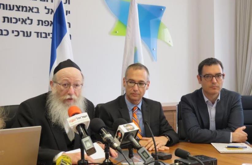 From left - Deputy Health Minister MK Ya'acov Litzman, Prof. Arnon Afek with orange tie and Moshe Bar Siman Tov. (photo credit: JUDY SIEGEL-ITZKOVICH)