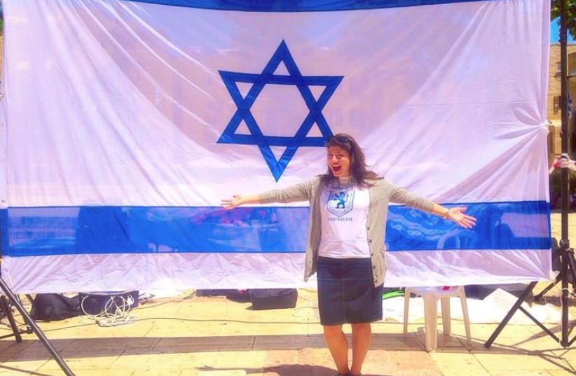 Jordana Brown with an Israeli flag (photo credit: JORDANA BROWN)