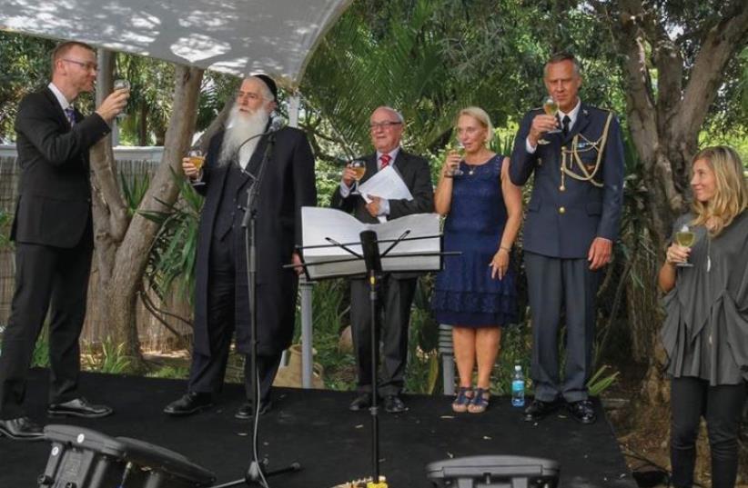 Swedish Ambassador Carl Magnus Nesser (left) and Deputy Education Minister Meir Porush (second left) at the Swedish National Day reception. (photo credit: Courtesy)
