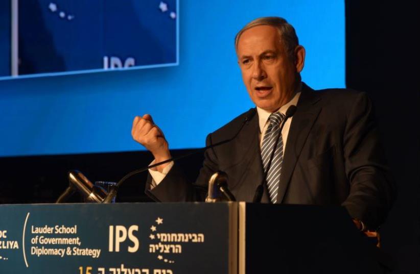 Prime Minister Benjamin Netanyahu delivers remarks at the Herzliya Conference (photo credit: AMOS BEN GERSHOM, GPO)