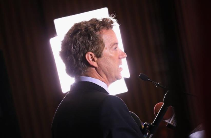 US Senator Rand Paul (Rep. - Ky.) prepares for a television interview (photo credit: AFP PHOTO)