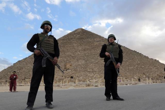 Police officers guard the Great Pyramid of Cheops in Giza (photo credit: REUTERS)