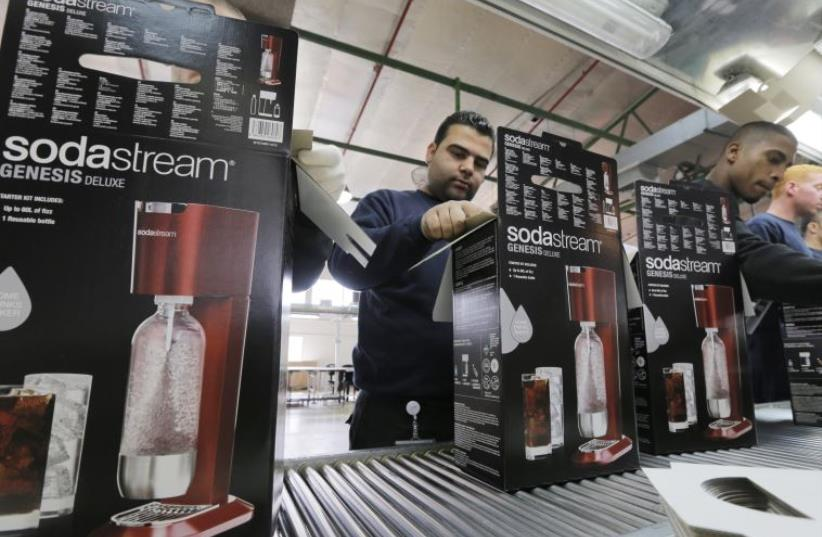 Employees pack boxes of the SodaStream product at the factory in Maaleh Adumim (photo credit: REUTERS)