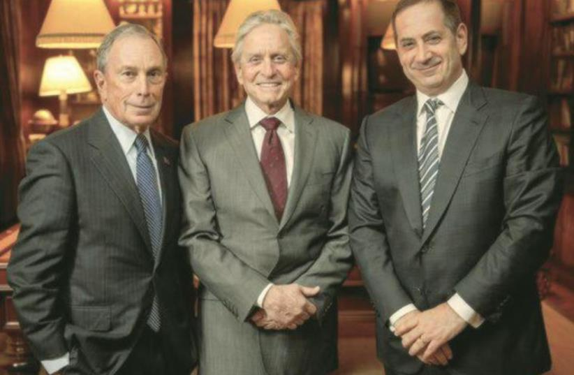 MICHAEL BLOOMBERG (left), Michael Douglas and Stan Polovets gather in New York City in January to celebrate the announcement of Douglas as the 2015 Genesis Prize laureate (photo credit: GENESIS PRIZE FOUNDATION)