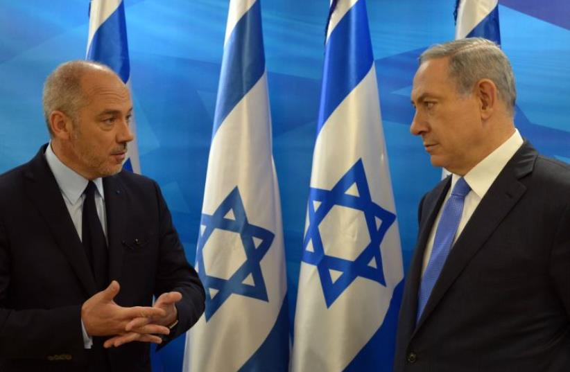 Chairman and CEO of Orange Stephane Richard and Prime Minister Benjamin Netanyahu (photo credit: CHAIM TZACH/GPO)