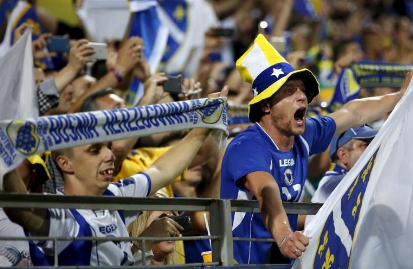 Fans of Bosnia cheer during their Euro 2016 qualifying soccer match against Israel in Bosnia and Herzegovina, June 12, 2015 (photo credit: REUTERS)