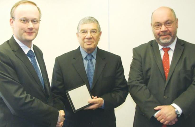 LUKASZ KAMINSKI (from left), president of the Institute of National Remembrance – Commission for the Prosecution of Crimes against the Polish Nation; Avner Shalev, chairman of the Holocaust Martyrs' and Heroes' Remembrance Authority Directorate; and Polish Ambassador Jacek Chodorowicz meet at Yad Va (photo credit: WITOLD MEDYKOWSKI/INP)