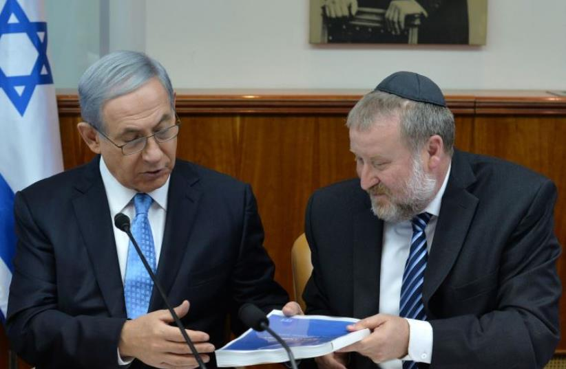 Prime Minister Benjamin Netanyahu receives report with findings on Operation Protective Edge.‏ (photo credit: KOBI GIDEON/GPO)
