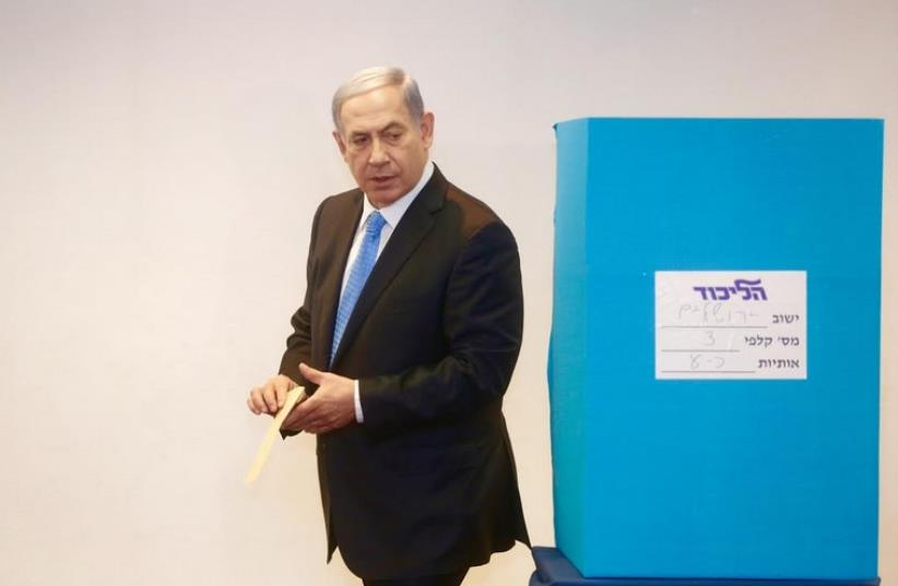 Prime Minister Benjamin Netanyahu votes on Sunday, June 14,  on a proposal to change how Israel's ruling party elects its MKs (photo credit: MARC ISRAEL SELLEM)