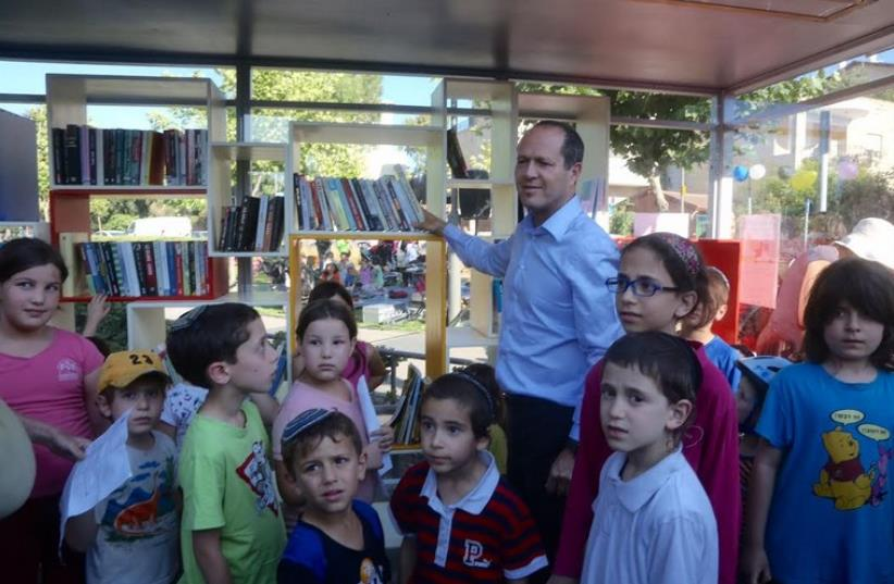 JERUSALEM MAYOR Nir Barkat and local children stand in front of the new library Sunday, June 14 (photo credit: MARC ISRAEL SELLEM)