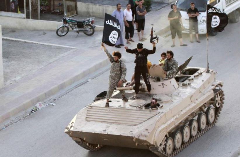 ISIS (photo credit: REUTERS)