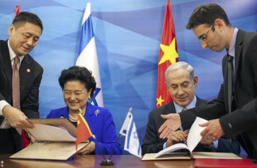 Prime Minister Benjamin Netanyahu and China's Vice Premier Liu Yandong sign an agreement in Jerusalem. (photo credit: REUTERS)
