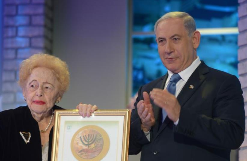 Esther Herlitz is applauded by Prime Minister Benjamin Netanyahu on receiving the Israel Prize, April 24. (photo credit: GPO)