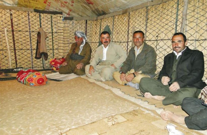 Kurdish nomads sit in a tent on Mount Halgurd, near the border with Iran border. (photo credit: TAMARA BARAAZ)