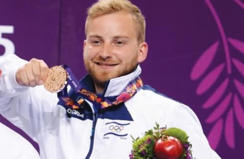 Israeli shooter Sergey Richter wins bronze medal at European Games (photo credit: OCI)