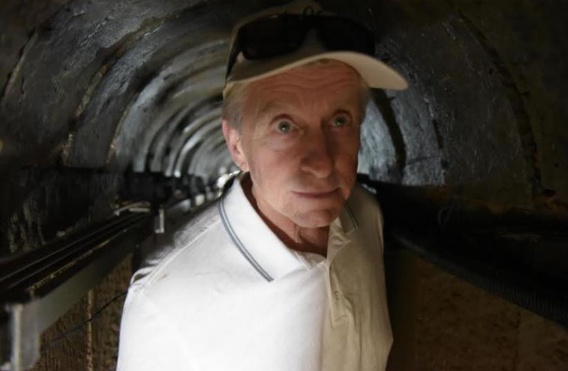 Oscar-winning actor Michael Douglas gets a glimpse of a terror tunnel near the Gaza border (photo credit: IDF)