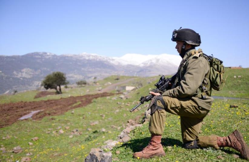An IDF soldier takes part in drills on the Golan Heights (photo credit: IDF)