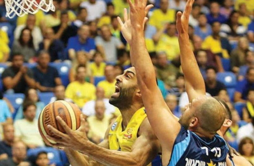 Maccabi Tel Aviv forward Brian Randle (left) will face a tough matchup tonight at Yad Eliyahu Arena against Hapoel Eilat's Elishay Kadir (right) in the decisive Game 5 of their teams' BSL semifinal series. (photo credit: Courtesy)