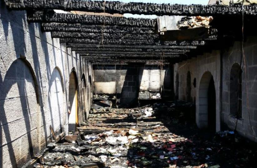 Suspected arson on Church of the Multiplication in the Galilee (photo credit: BEN HARTMAN)