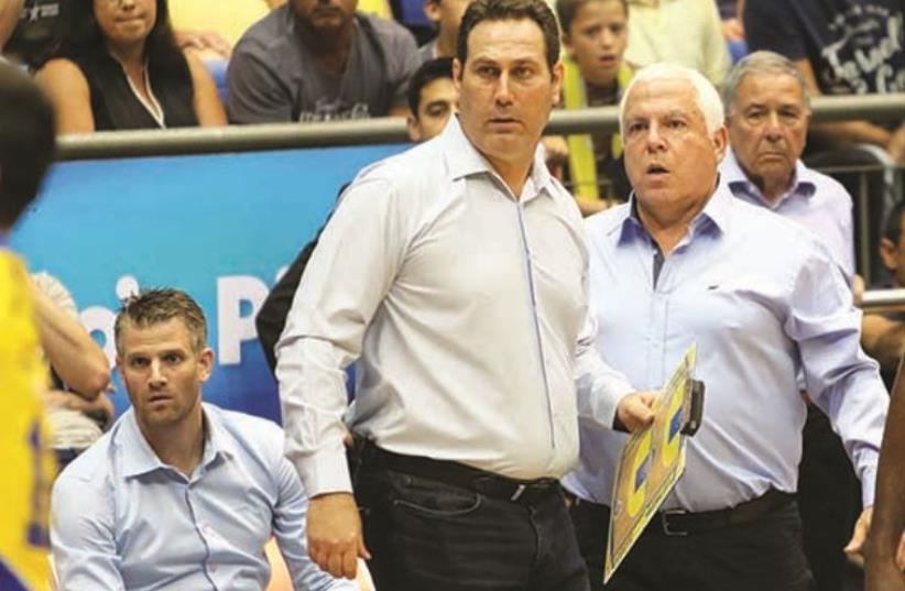 Despite having a guaranteed contract for next season, Guy Goodes (center) may have coached his final game for Maccabi Tel Aviv (photo credit: ADI AVISHAI)