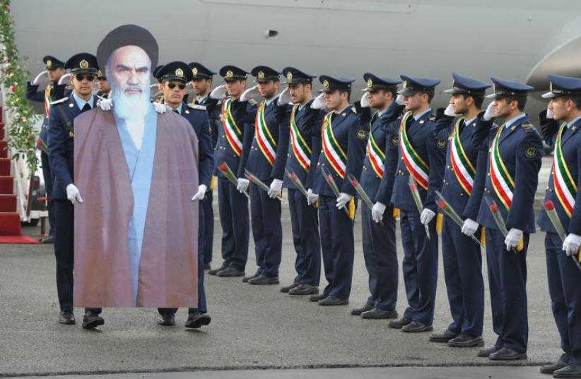 Members of the Iranian air force re-enact the scene of founder of the Islamic Republic Ayatollah Ruhollah Khomeini's arrival to Iran in 1979 at Merhrabad airport (photo credit: REUTERS)