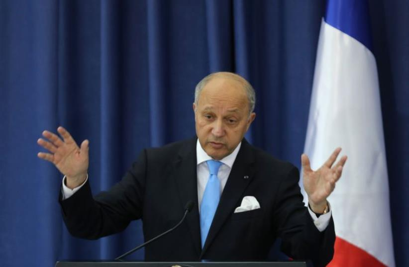 French Foreign Minister Laurent Fabius gestures during a press conference at the Mukataa compound, in the West Bank city of Ramallah, on June 21, 2015.  (photo credit: ABBAS MOMANI / AFP)