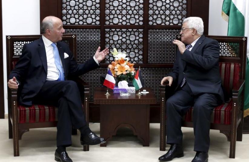 France's Foreign Minister Laurent Fabius (L) gestures as he meets Palestinian President Mahmoud Abbas (photo credit: REUTERS)
