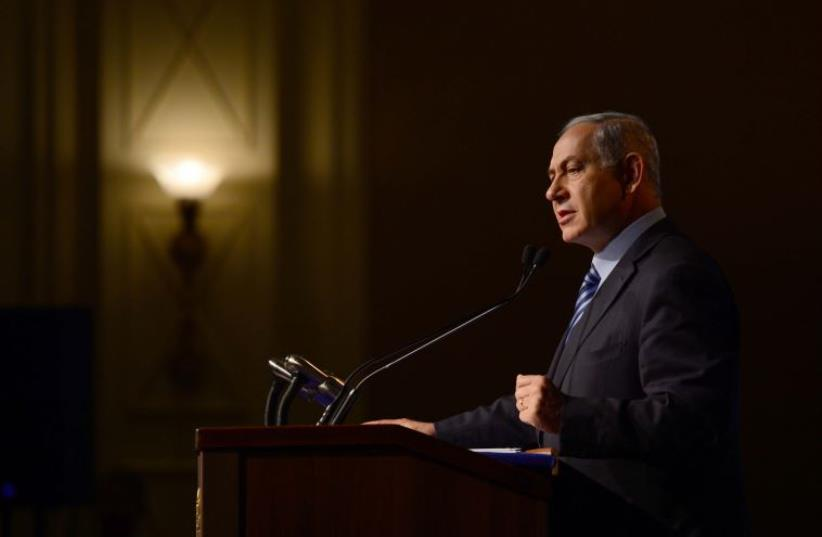 Netanyahu speaks at the Jewish Agency's conference. (photo credit: AVI OHAYON - GPO)