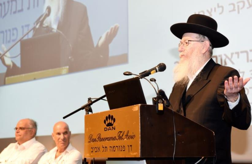 Ya'acov Litzman speaks to an audience at Tel Aviv's Dan Panorama Hotel (photo credit: Courtesy)