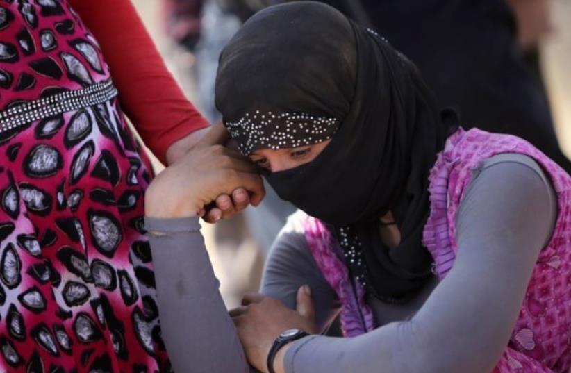 Yazidi refugee. (photo credit: AHMAD AL-RUBAYE / AFP)