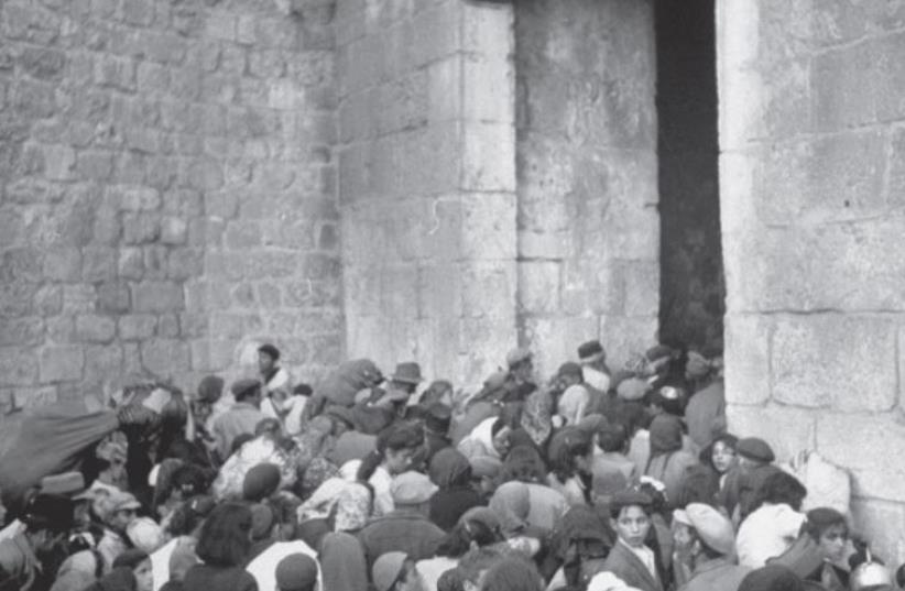 EXPELLED JEWS are shoved out of Zion Gate in Jerusalem after it was conquered by the Arab Legion (photo credit: JERUSALEM POST ARCHIVE)