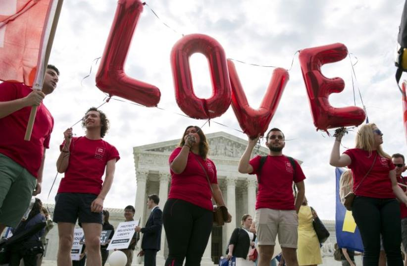 Supporters of gay marriage rally in front of the Supreme Court in Washington (photo credit: REUTERS)
