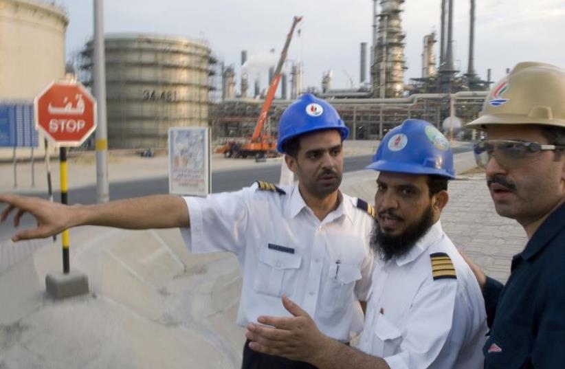 Employess of Kuwait National Petroleum Co. (file) (photo credit: REUTERS)