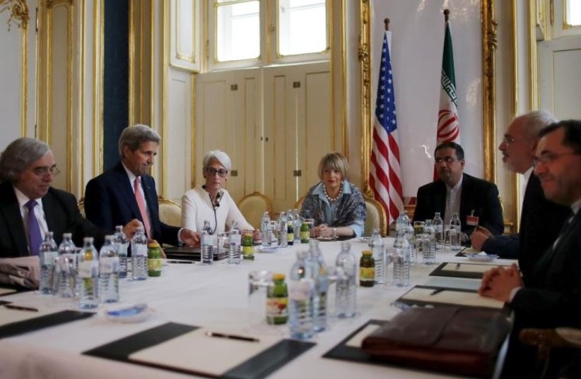 US Secretary of Energy Ernest Moniz, US Secretary of State John Kerry and U.S. Under Secretary for Political Affairs Wendy Sherman (L-3rd L) meet with Iranian Foreign Minister Mohammad Javad Zarif (2nd R) at a hotel in Vienna, Austria June 27, 2015. (photo credit: REUTERS)