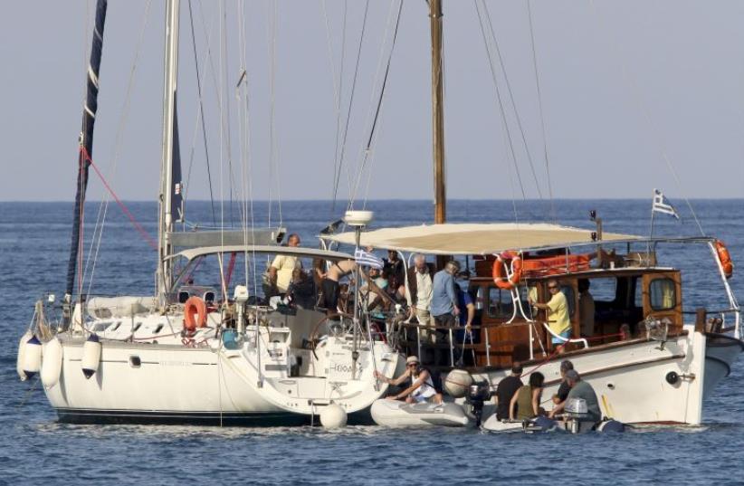 Activists aboard a flotilla to Gaza. (photo credit: REUTERS)