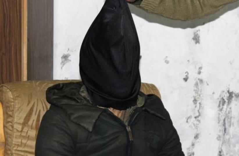 ISIS interrogation (illustrative) (photo credit: REUTERS)