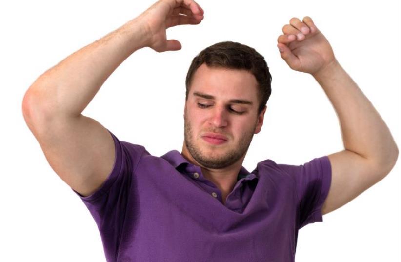 Man with Hyperhidrosis sweating very badly under armpit (photo credit: INGIMAGE)