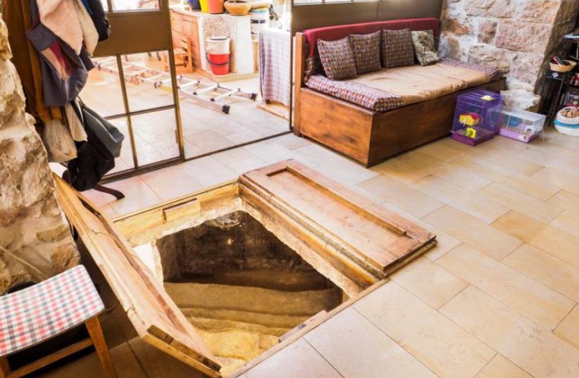 Archeological treasure found underneath Jerusalem livingroom. (photo credit: ASAF PERETZ/ISRAEL ANTIQUITIES AUTHORITY)