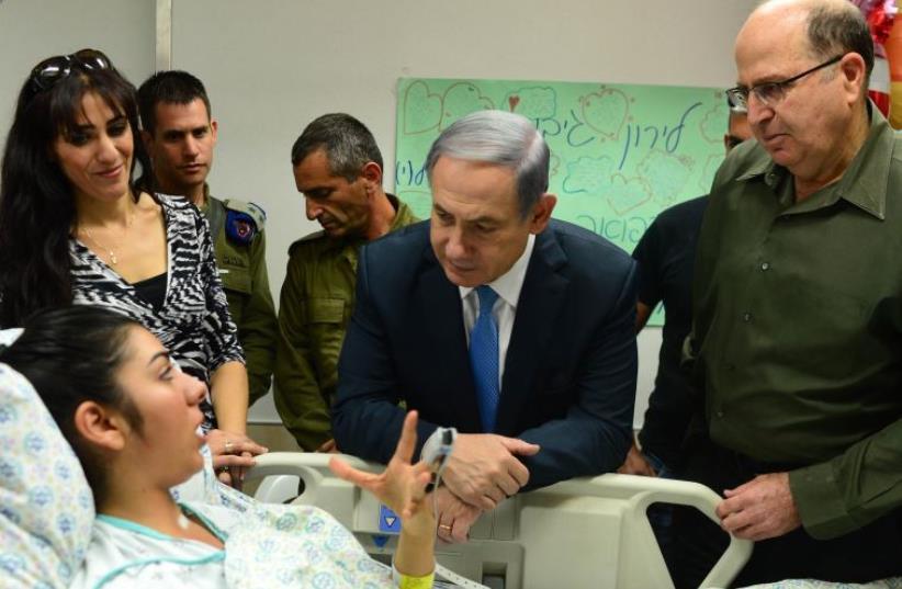 Netanyahu and Ya'alon visit terrorist victims (photo credit: KOBI GIDEON/GPO)