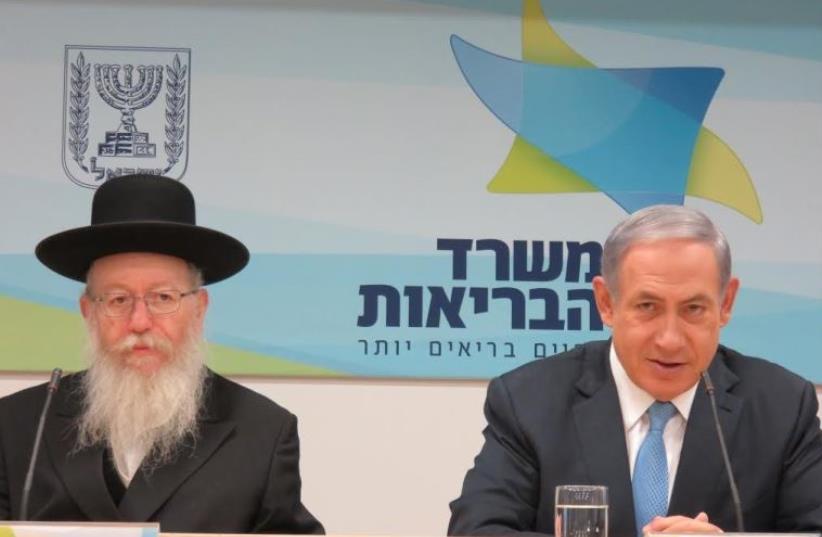 Prime Minister (and, formal) Health Minister Benjamin Netanyahu (R) and Deputy Health Minister MK Ya'acov Litzman (photo credit: JUDY SIEGEL-ITZKOVICH)