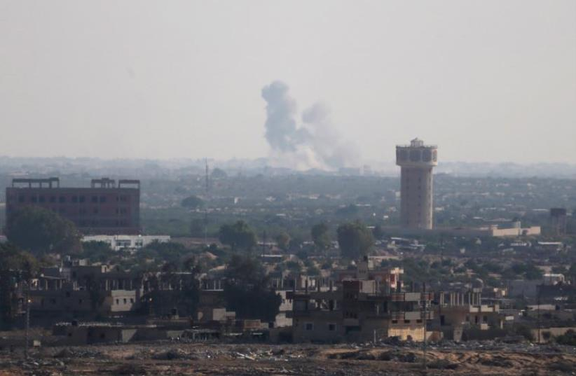 Smoke rises in Egypt's North Sinai as seen from the border of southern Gaza Strip with Egypt July 1, 2015.  (photo credit: REUTERS)