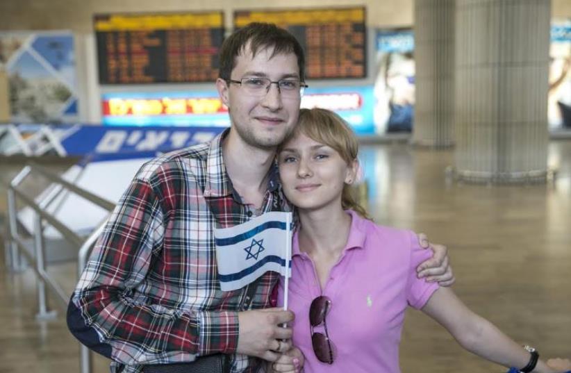 ROMAN MAKRIA and Sasha Malinka arrive at Ben-Gurion Airport on Wednesday. (photo credit: BAZ RATNER)