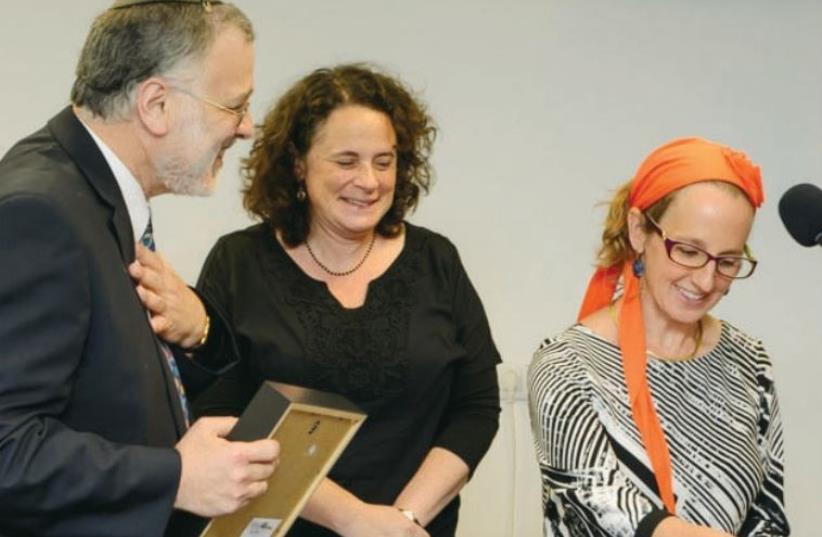 Rabbi Herzl Hefter congratulates Rahel Berkovits and Dr. Meesh Hammer-Kossoy on achieving smicha, becoming rabbis, or called 'rabba.' (photo credit: COURTESY RABBI HERZL HEFTER)