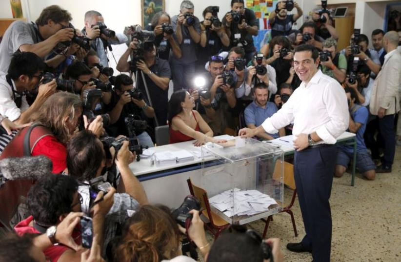 Greek Prime Minister Alexis Tsipras votes at a polling station in Athens, Greece July 5, 2015. (photo credit: REUTERS)