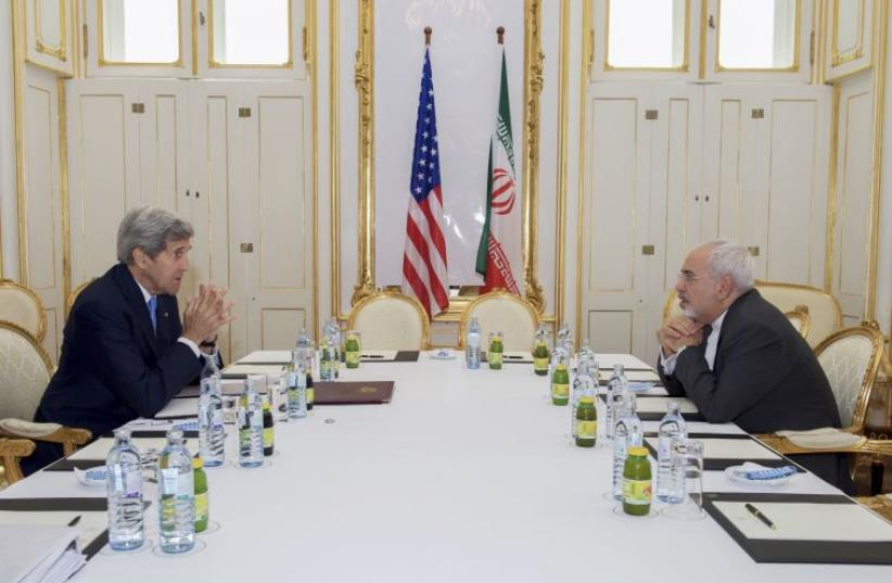 IRAN-NUCLEAR/ RTX1IHEE 30 Jun. 2015 Vienna, Austria U.S. Secretary of State John Kerry (L) meets with Iranian Foreign Minister Javad Zarif at a hotel in Vienna, Austria June 30, 2015. (file) (photo credit: REUTERS)