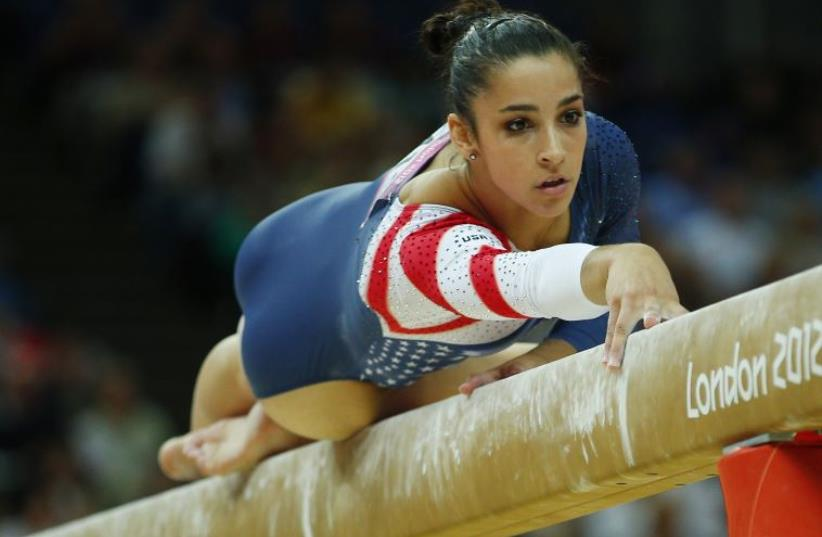 Alexandra Raisman of the US competes in the women's gymnastics balance beam final in the North Greenwich Arena during the London 2012 Olympic Games (photo credit: REUTERS)